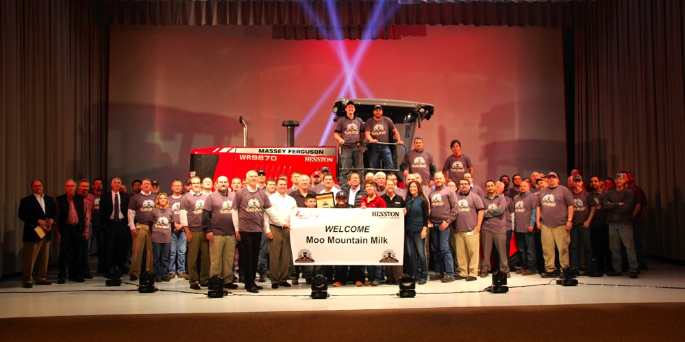 Rank-and-file assembly workers joined executives and customers for a group photo during the 100,000th swather celebration earlier this year.