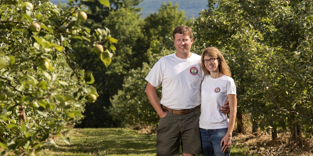 Andrew and Jennifer Lovell in their apple orchard.