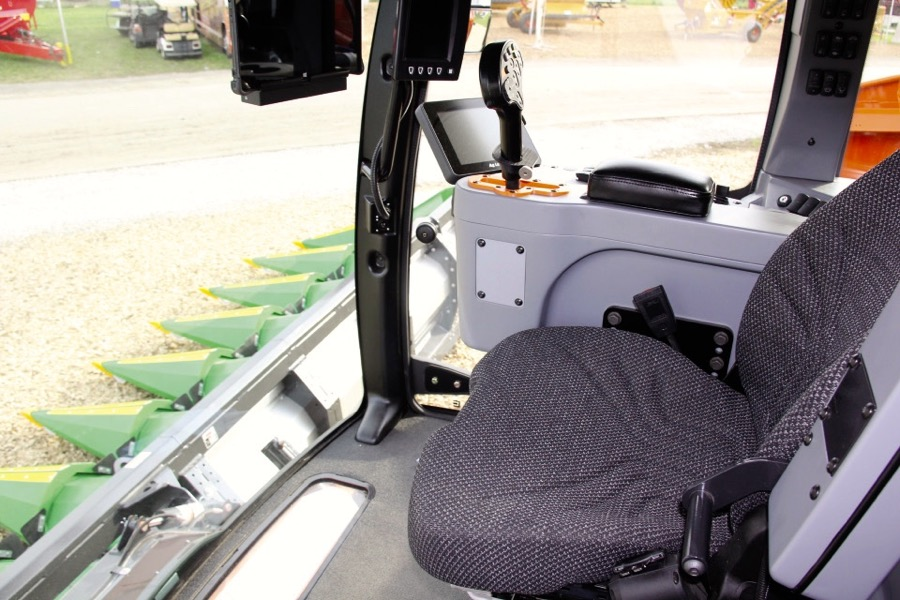 Climb inside the Tribine cab and you'll find one thing missing, a conventional steering wheel.