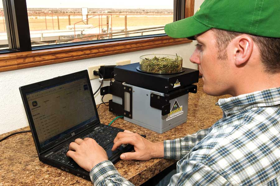Man working at a laptop.