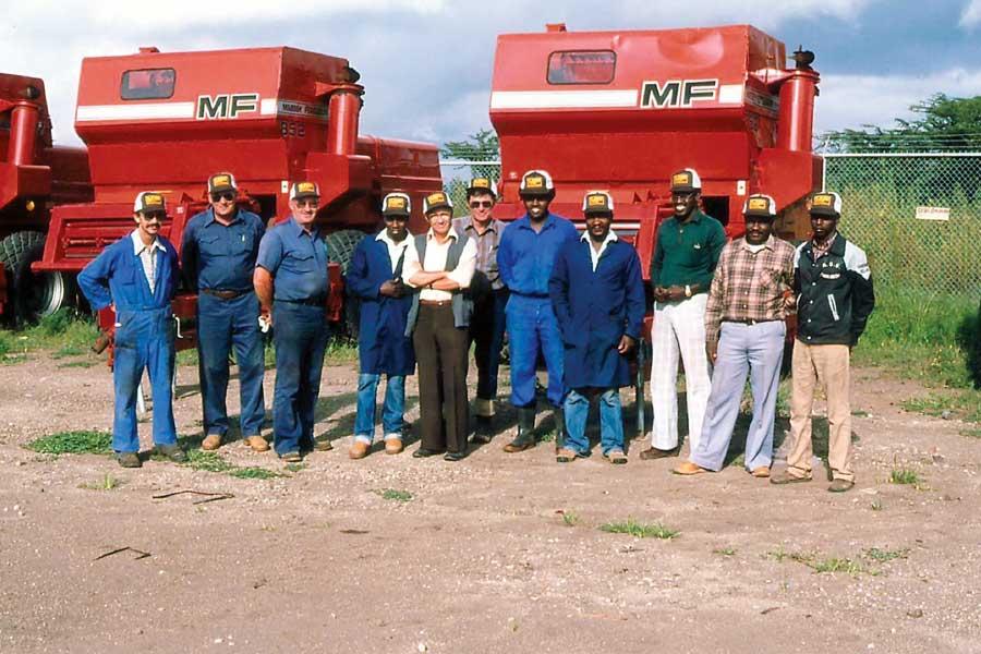 Men standing with farm equipment