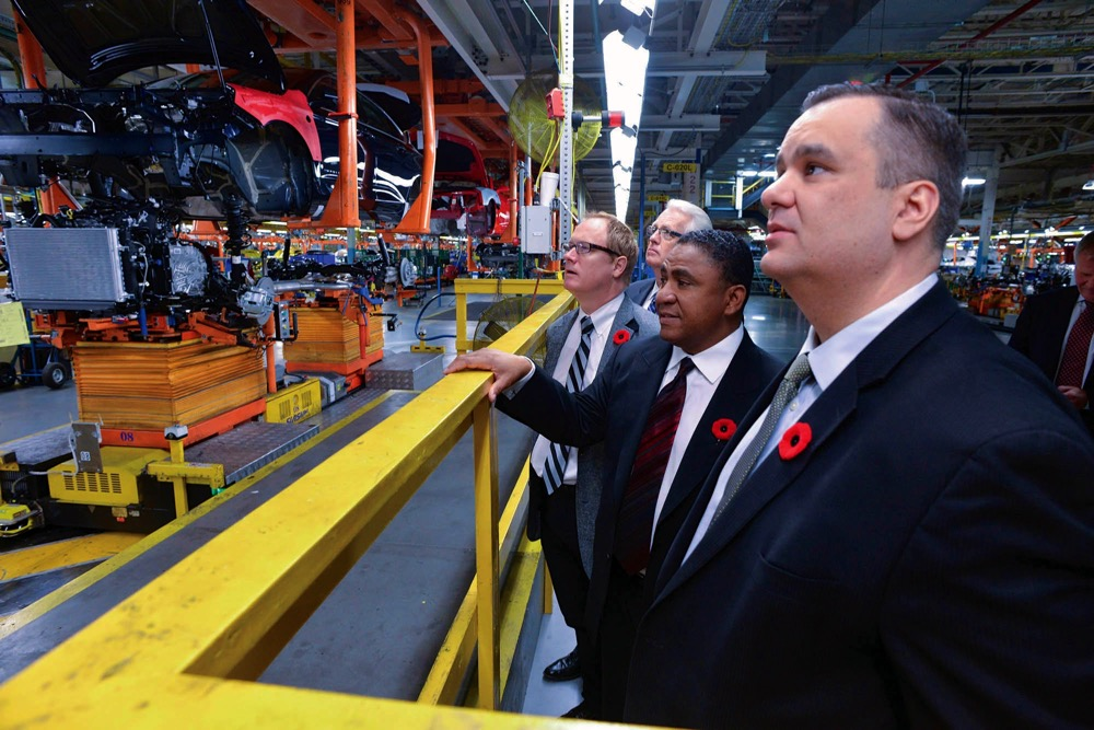Industry Minister James Moore on a promotion visit for CETA