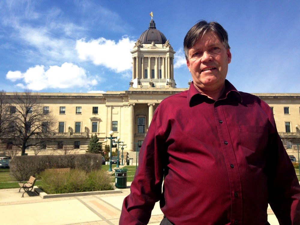 Ian Wishart standing in front of Manitoba Legislature