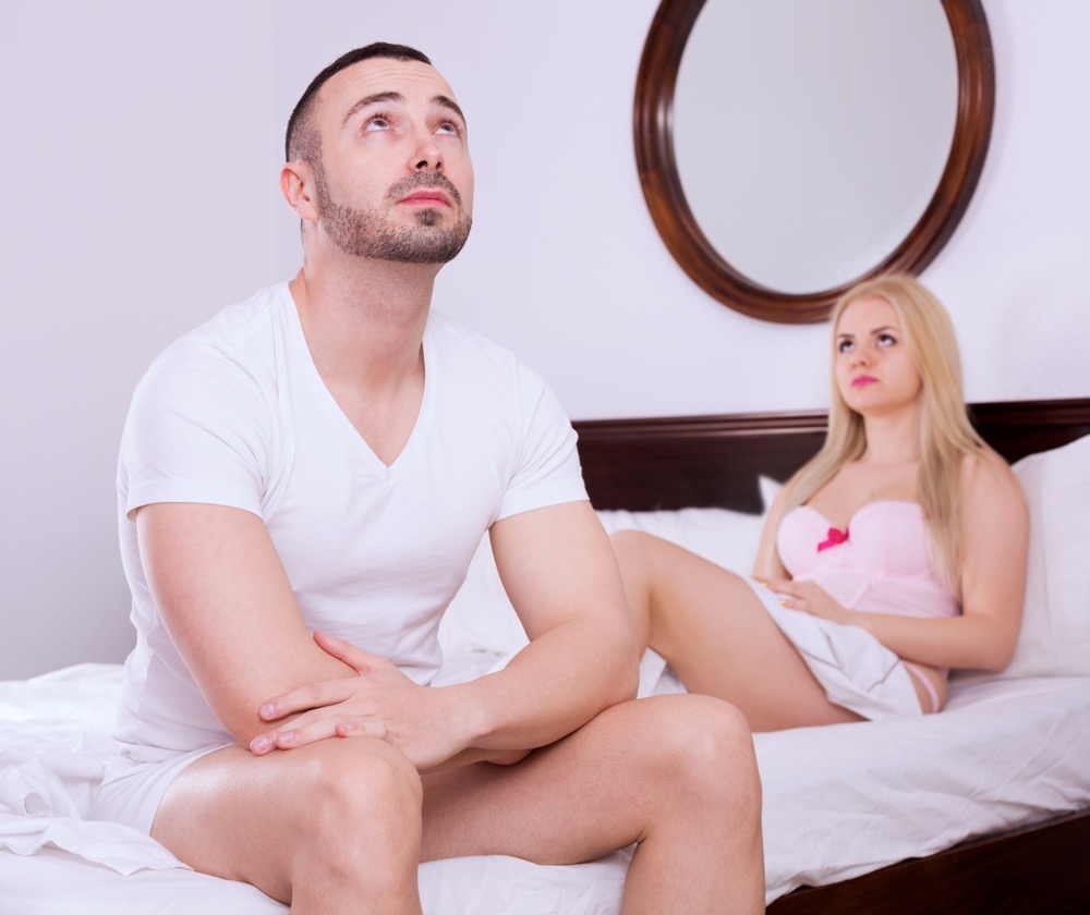 Wife and husband having difficulties in bed