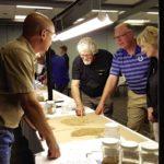 Randy Dennis (l), chief grain inspector for Canada talks to farmers attending the grain grading seminar in Yorkton, Sask.