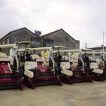 These combine harvesters are part of the fleet of farm equipment at Jianhu Lantian Agricultural Machinery Co-operative, established in 2007 near Yancheng in Jiangsu Province.