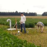 Students work at seeding the lysimeters by hand at the Elora Research Station.