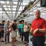 Jan VanderHout hosts a food tour at his greenhouses.