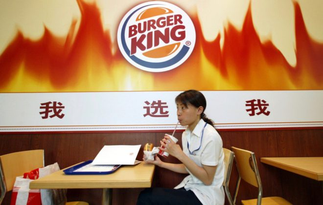 A customer dines at a Burger King outlet in Shanghai on June 27, 2005. (File photo: Reuters/Ming Ming)