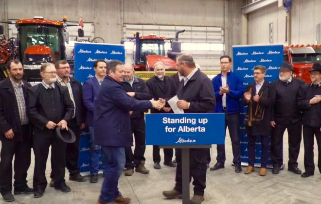 Alberta Premier Jason Kenney steps up to speak at Jumbo Valley Hutterite Colony on Oct. 3, 2019. (Video screengrab from Alberta.ca via YouTube)
