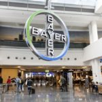 Bayer's cross symbol hangs in a terminal at Frankfurt International Airport. (Typhoonski/iStock Editorial/Getty Images)