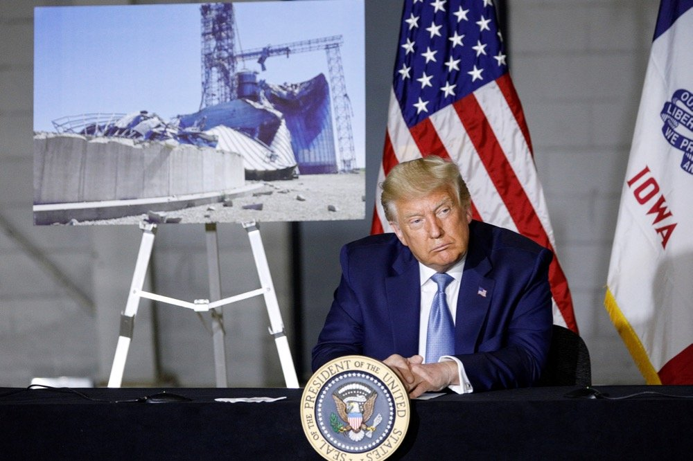 U.S. President Donald Trump participates in a disaster recovery briefing following last week's severe windstorm, at the Eastern Iowa Airport in Cedar Rapids on Aug. 18, 2020. (Photo: Reuters/Tom Brenner)