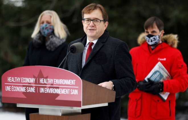 Environment Minister Jonathan Wilkinson, with Infrastructure Minister Catherine McKenna (l) and Heritage Minister Steven Guilbeault (r), speaks at the Dominion Arboretum in Ottawa on Dec. 11, 2020. (Photo: Reuters/Blair Gable)
